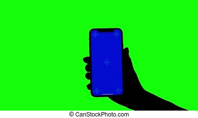 Female hand holds upright smartphone on green screen -...