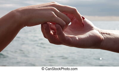 Female hand in a man's hand