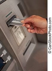 Female hand inserting ATM card - Female hand inserting a...