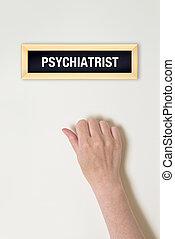 Female hand is knocking on Psychiatrist door