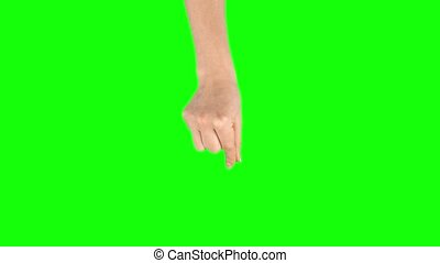 Female hand is performing pinch at tablet screen gesture on ...