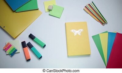 Female hand opening notepad on the table