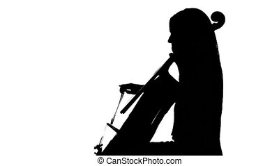 Female hand plays on a cello in white studio music sheets....