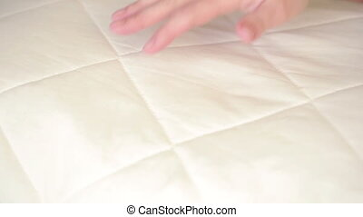 female hand pressing on the pillow. soft pillow