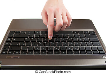 female hand pushing a button on laptop keyboard with the finger
