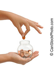 female hand putting a coin into glass bottle, concept saving for