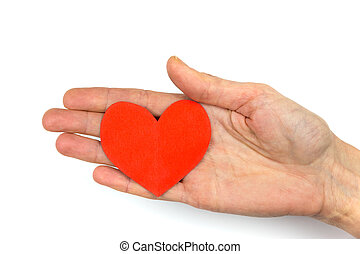 Female hand showing red paper heart as symbol of love