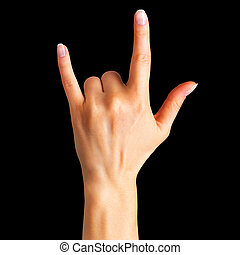 Female hand showing rock n roll sign or giving the devil horns gesture