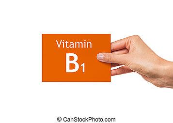 Female hand shows a card with the inscription Vitamin B1. ...
