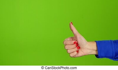 Female hand, sign language. Thumb up and then thumb down -...