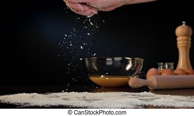 Female Hand Spreading Flour on the Table - Female hand...