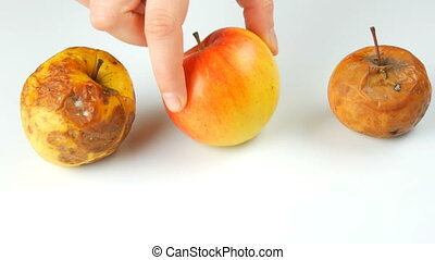 Female hand takes ripe juicy and fresh apple and puts...