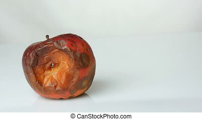 Female hand takes ripened apple and puts ripe juicy and...