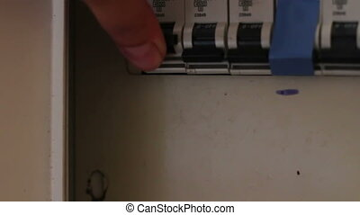 Female hand toggle switch in the switch box, All switches being turned on and off. Electricity, power
