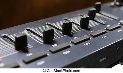 female hand tunes midi synthesizer keyboard - female hand...