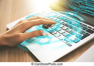 Female hand using digital laptop