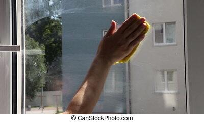 female hand washing the window