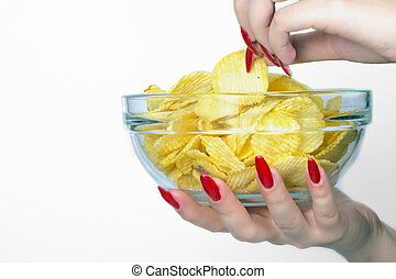 Female hand with chips