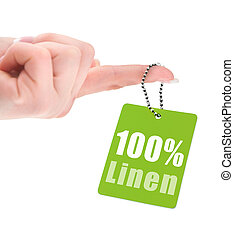 female hand with hundred percent linen tag