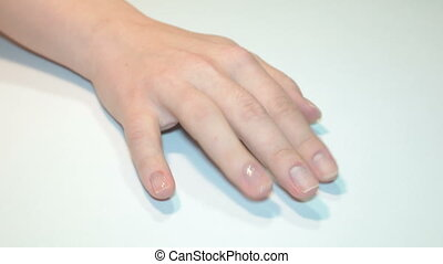 female hand with manicure on the table.