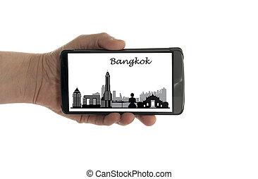 female hand with mobile phone Bangkok skyline