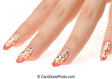 Female hand with nail art - figure a camomile. It is...