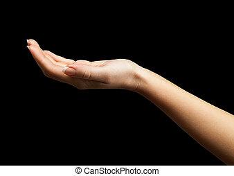 Female hand with open palm over black background