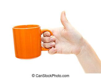 Female hand with orange teacup