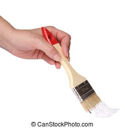 Female hand with paintbrush