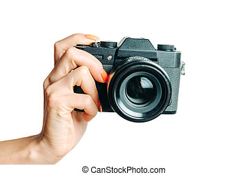 Female hand with photo camera on a white background.