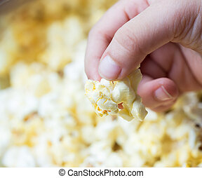 Female hand with popcorn