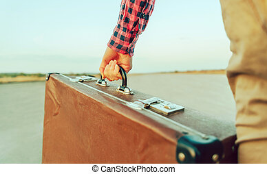 Female hand with suitcase
