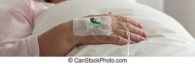 Female hand with venous catheter