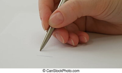 Female hand writes I love you on the paper sheet
