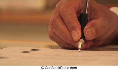 Female hand writing pen