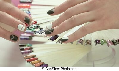 Female hands and wheel of nail art.