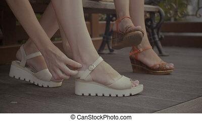 Female hands attaching blister plaster on heel