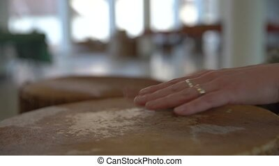 female hands beating the bongo drum in the musical hall