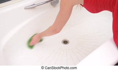 Female hands cleaning bath faucet. 4k, slow motion