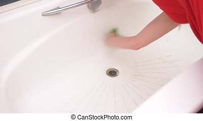 Female hands cleaning bath faucet. slow motion