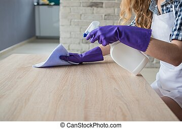 Female hands cleaning table