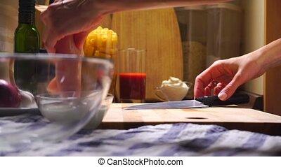 Female hands cutting chicken fillet clip