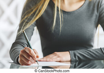 Female hands doing paperwork