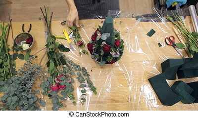 Female hands florist prepare materials for working with blanks bouquet.
