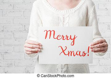 Female hands hold inscription Merry Christmas