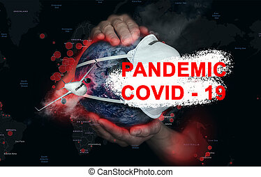 Female hands hold the Earth in a medical protective mask on the background of a map with foci of infection during the epidemic Covid19. Concept