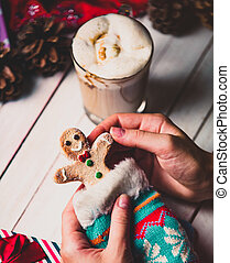 female hands holding a cookie in the sock