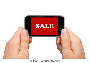 female hands holding a phone touch computer pad gadget with the word sale on a red screen