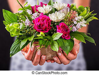 female hands holding gift and beautiful vintage wedding...