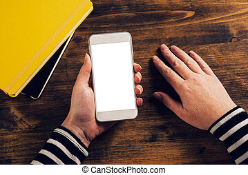 Female hands holding mobile smarthone with blank screen